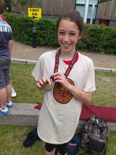 Kati Hulme with her Wenlock Games high jump gold medal